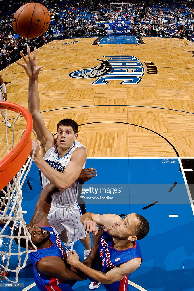 Nikola Vucevic #9 of the Orlando Magic shoots in the lane against Jason Maxiell #54 and Tayshaun Prince #22 of the Detroit Pistons on November 21, 2012 at Amway Center in Orlando, Florida.