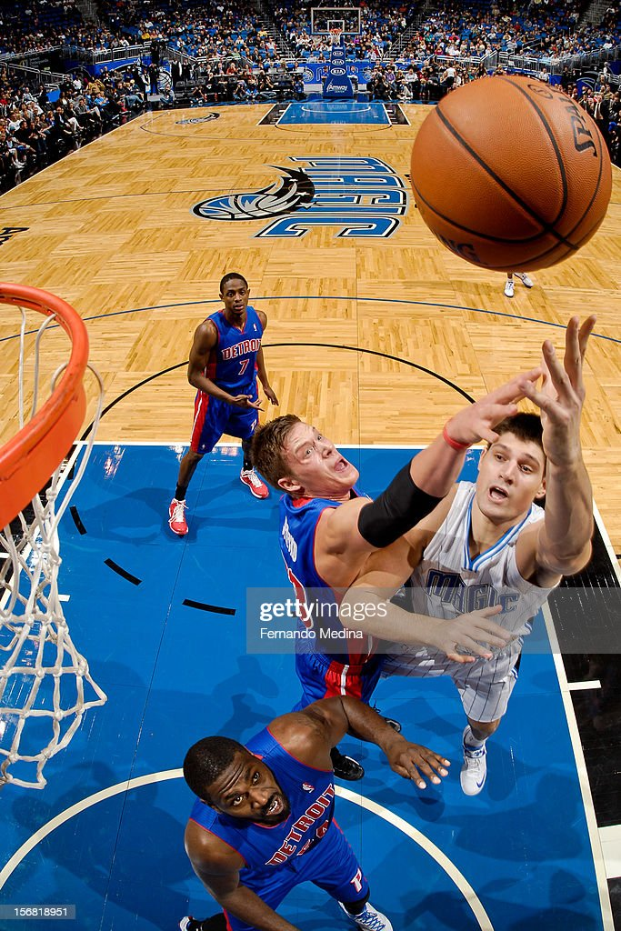 Nikola Vucevic #9 of the Orlando Magic shoots in the lane against <a gi-track='captionPersonalityLinkClicked' href=/galleries/search?phrase=Jonas+Jerebko&family=editorial&specificpeople=5942357 ng-click='$event.stopPropagation()'>Jonas Jerebko</a> #33 of the Detroit Pistons on November 21, 2012 at Amway Center in Orlando, Florida.