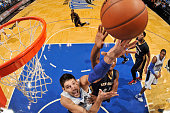 Nikola Vucevic of the Orlando Magic shoots the ball against the New Orleans Pelicans during a preseason game on October 21 2015 at Amway Center in...