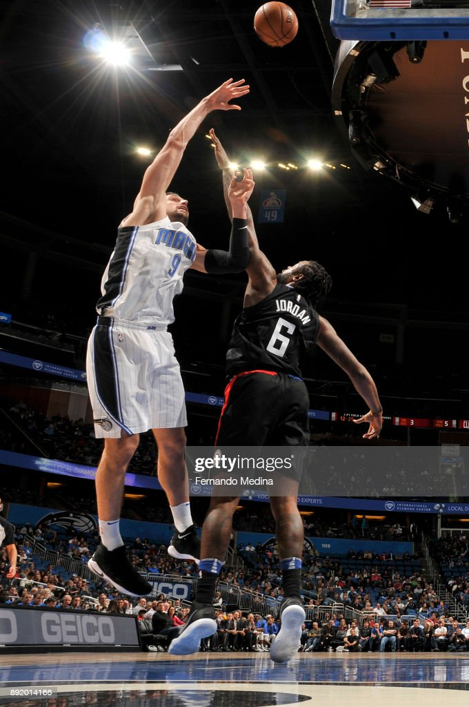 Nikola Vucevic #9 of the Orlando Magic shoots the ball against the LA Clippers on December 13, 2017 at Amway Center in Orlando, Florida.