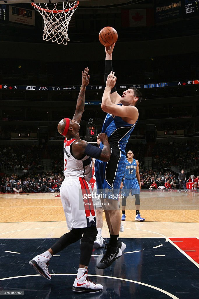 Nikola Vucevic #9 of the Orlando Magic shoots the ball against the Washington Wizards during the game at the Verizon Center on February 25, 2014 in Washington, DC.