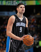 Nikola Vucevic of the Orlando Magic takes a free throw against the Denver Nuggets at Pepsi Center on January 7 2015 in Denver Colorado The Nuggets...