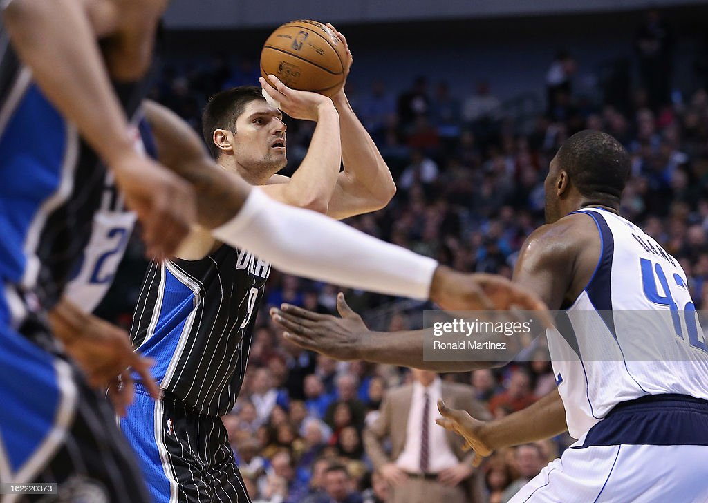 Nikola Vucevic #9 of the Orlando Magic takes a shot against Elton Brand #42 of the Dallas Mavericks at American Airlines Center on February 20, 2013 in Dallas, Texas.