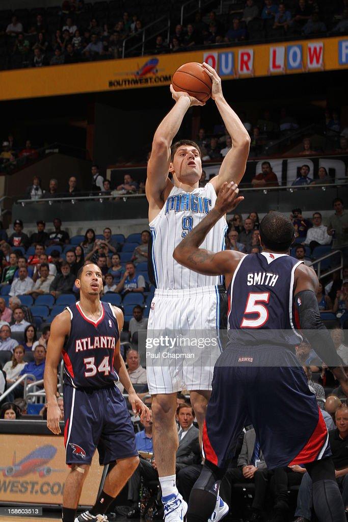 Nikola Vucevic #9 of the Orlando Magic takes a shot against the Atlanta Hawks on December 12, 2012 at Amway Center in Orlando, Florida.