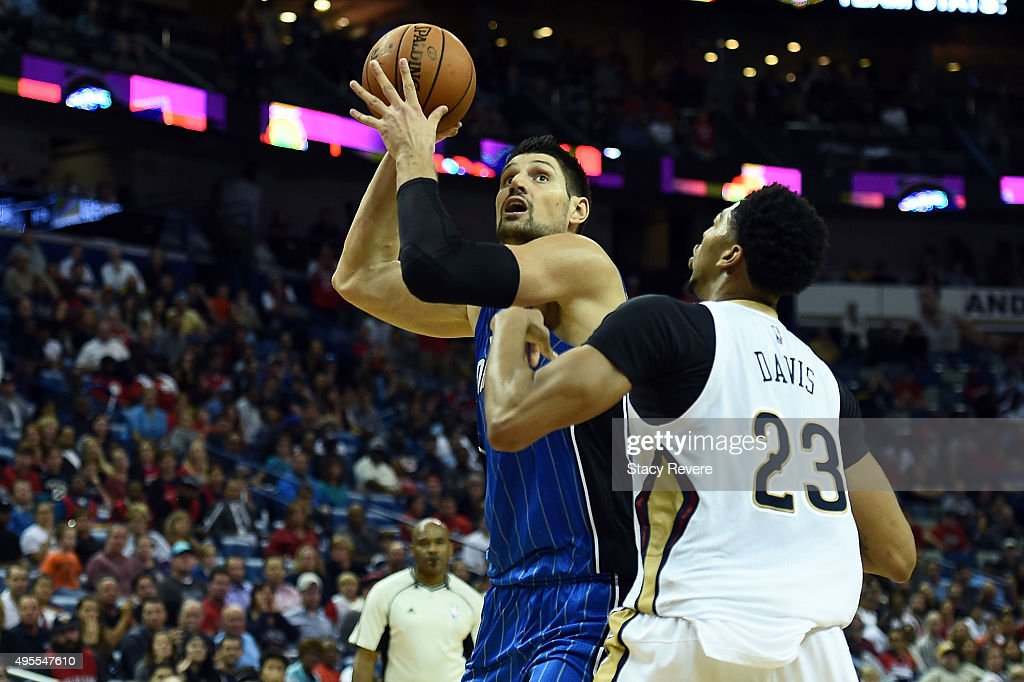 Nikola Vucevic #9 of the Orlando Magic works against Anthony Davis #23 of the New Orleans Pelicans during the second half of a game at the Smoothie King Center on November 3, 2015 in New Orleans, Louisiana.