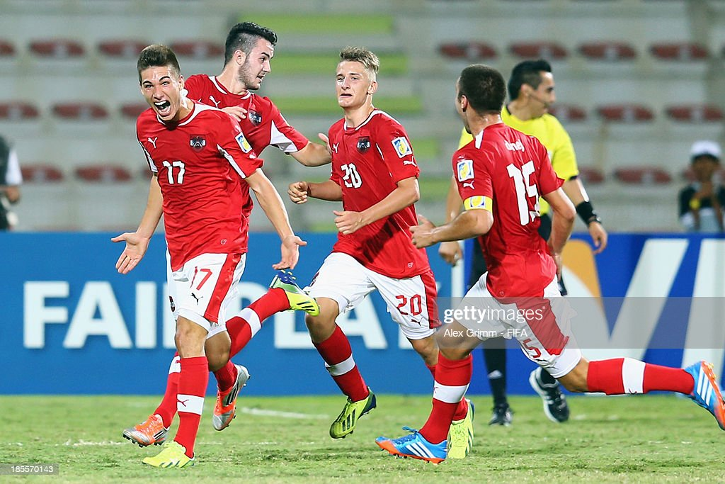 Nikola Zivotic (L) of Austria celebrates his team's first goal with team mates during the FIFA U-17 World Cup UAE 2013 Group E match between Argentina and Austria at Al Rashid Stadium on October 22, 2013 in Dubai, United Arab Emirates.