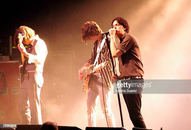 Nikolai Fraiture Nick Valensi and Julian Casablancas of The Strokes perform at 'The Theatre' at Madison Square Garden on October 28 2003 in New York...