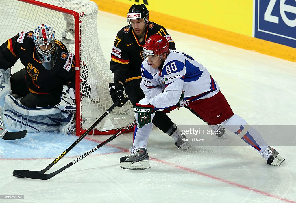 Nikolai Goc (#77) of Germany and Kirill Petrov (#90) of Russia battle for the puck during the IIHF World Championship group H match between Germany and Russia at Hartwall Areena on May 5, 2013 in Helsinki, Finland.