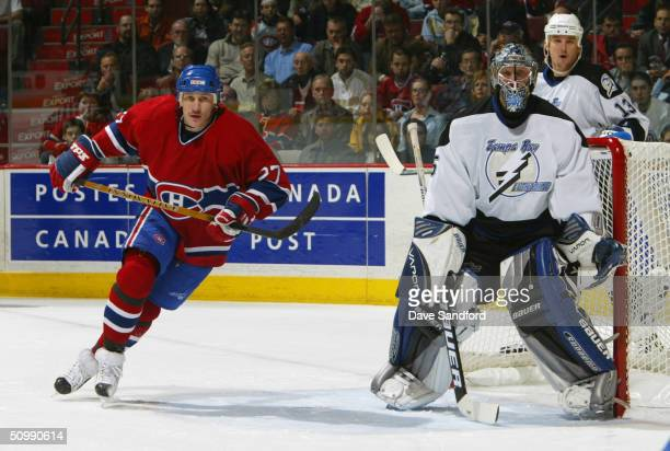 Nikolai Khabibulin of the Tampa Bay Lightning eyes the play as Alexei Kovalev of the Montreal Canadiens skates throught the slot during game three of...