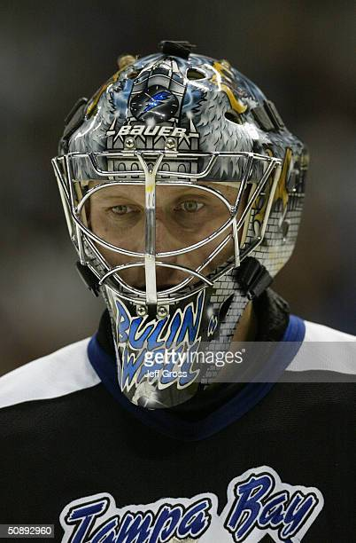 Nikolai Khabibulin of the Tampa Bay Lightning looks on during a break in action against the Montreal Canadiens during game one of the Eastern...