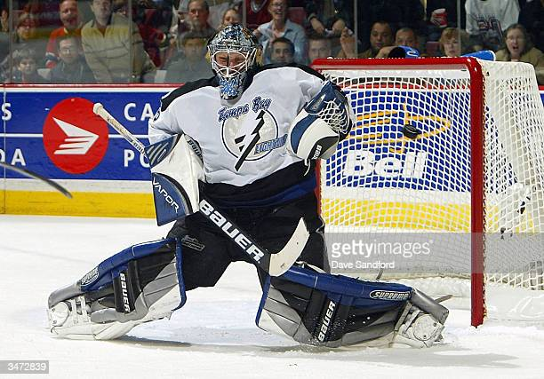 Nikolai Khabibulin of the Tampa Bay Lightning makes a save on a shot from the Montreal Canadiens in Game three of the Eastern Conference Semifinals...