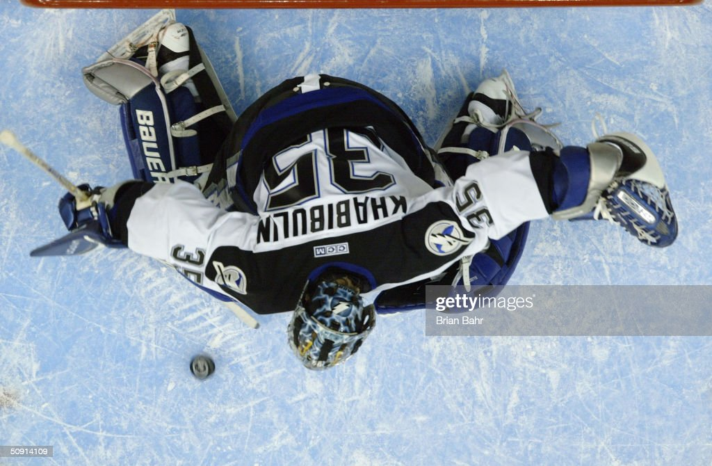Nikolai Khabibulin #35 of the Tampa Bay Lightning stops a shot against the Calgary Flames in game four of the NHL Stanley Cup Finals on May 31, 2004 at the Pengrowth Saddledome in Calgary, Canada. The Lightning won 1-0.