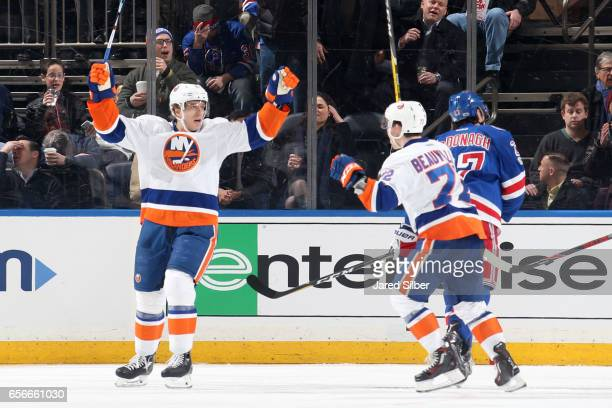 Nikolai Kulemin and Anthony Beauvillier of the New York Islanders makes a blocker save in the first period against the New York Rangers at Madison...