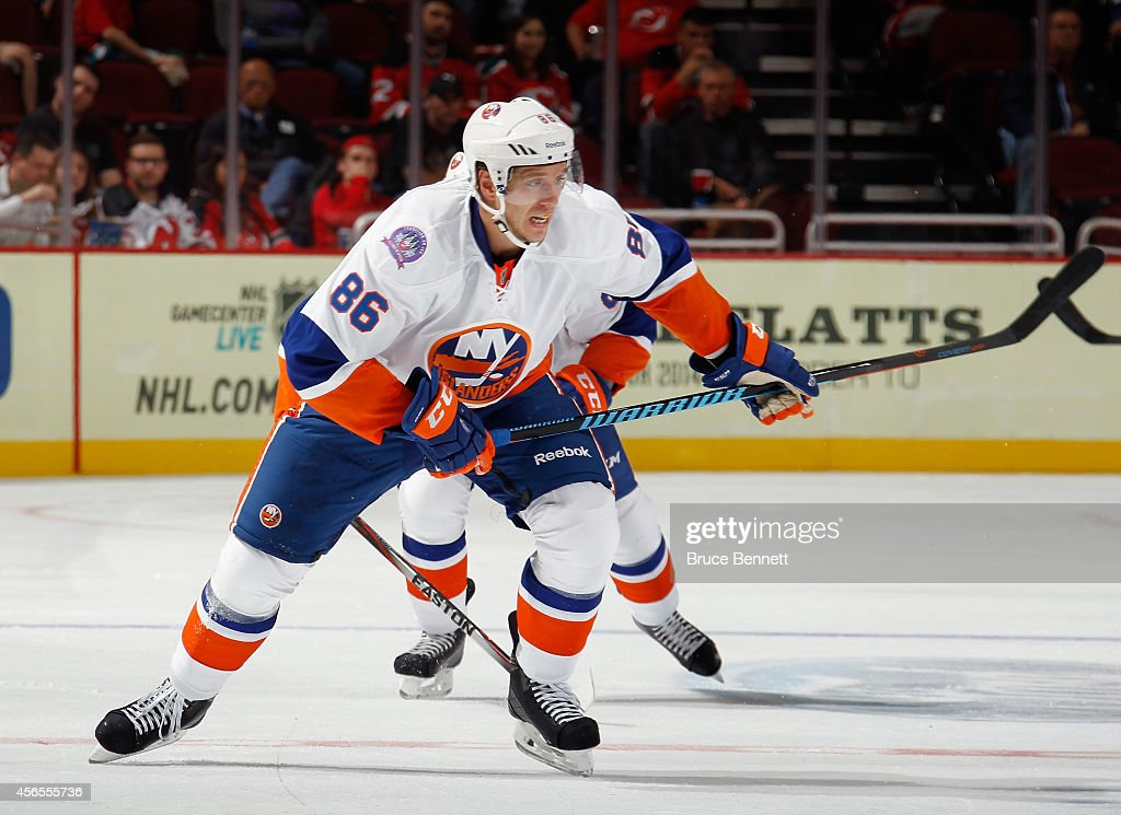 Nikolai Kulemin of the New York Islanders skates against the New Jersey Devils at the Prudential Center on October 2 2014 in Newark New Jersey The...