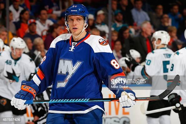 Nikolai Kulemin of the New York Islanders skates against the San Jose Sharks at Nassau Veterans Memorial Coliseum on October 16 2014 in Uniondale New...