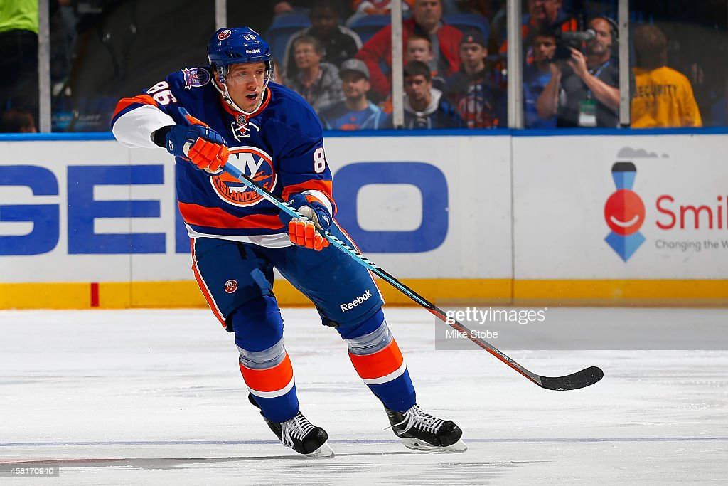 Nikolai Kulemin of the New York Islanders skates against the Toronto Maple Leafs at Nassau Veterans Memorial Coliseum on October 21 2014 in Uniondale...