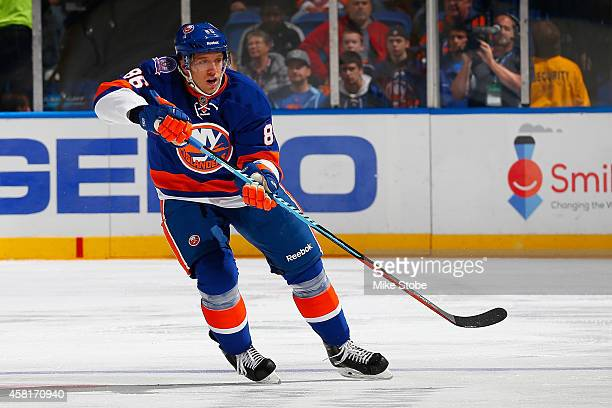 Nikolai Kulemin of the New York Islanders skates against the Toronto Maple Leafs at Nassau Veterans Memorial Coliseum on October 21 2014 in Uniondale...