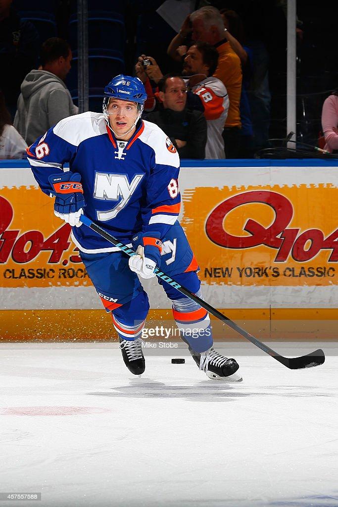 Nikolai Kulemin of the New York Islanders skates during warmups prior to their game against the San Jose Sharks at Nassau Veterans Memorial Coliseum...