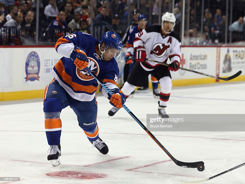 Nikolai Kulemin of the New York Islanders takes the first period shot against the New Jersey Devils at the Barclays Center on September 26 2014 in...
