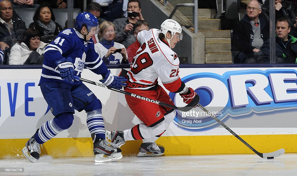 <a gi-track='captionPersonalityLinkClicked' href=/galleries/search?phrase=Nikolai+Kulemin&family=editorial&specificpeople=537949 ng-click='$event.stopPropagation()'>Nikolai Kulemin</a> #41 of the Toronto Maple Leafs battles for the puck with <a gi-track='captionPersonalityLinkClicked' href=/galleries/search?phrase=Alexander+Semin&family=editorial&specificpeople=206654 ng-click='$event.stopPropagation()'>Alexander Semin</a> #28 of the Carolina Hurricanes during NHL game action February 4, 2013 at the Air Canada Centre in Toronto, Ontario, Canada.
