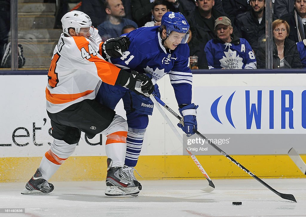 <a gi-track='captionPersonalityLinkClicked' href=/galleries/search?phrase=Nikolai+Kulemin&family=editorial&specificpeople=537949 ng-click='$event.stopPropagation()'>Nikolai Kulemin</a> #41 of the Toronto Maple Leafs battles for the puck with <a gi-track='captionPersonalityLinkClicked' href=/galleries/search?phrase=Kimmo+Timonen&family=editorial&specificpeople=201521 ng-click='$event.stopPropagation()'>Kimmo Timonen</a> #44 of the Philadelphia Flyers during NHL game action February 11, 2013 at the Air Canada Centre in Toronto, Ontario, Canada.