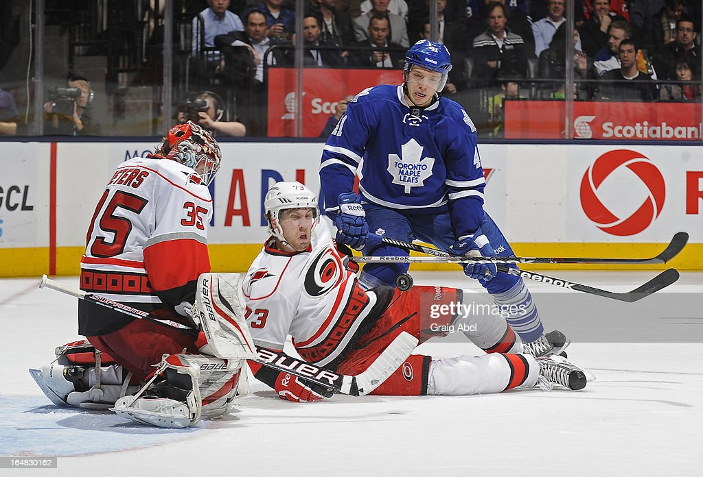 <a gi-track='captionPersonalityLinkClicked' href=/galleries/search?phrase=Nikolai+Kulemin&family=editorial&specificpeople=537949 ng-click='$event.stopPropagation()'>Nikolai Kulemin</a> #41 of the Toronto Maple Leafs battles for the puck with Brett Bellemore #73 of the Carolina Hurricanes as Justin Peters #35 defends the goal during NHL game action March 28, 2013 at the Air Canada Centre in Toronto, Ontario, Canada.