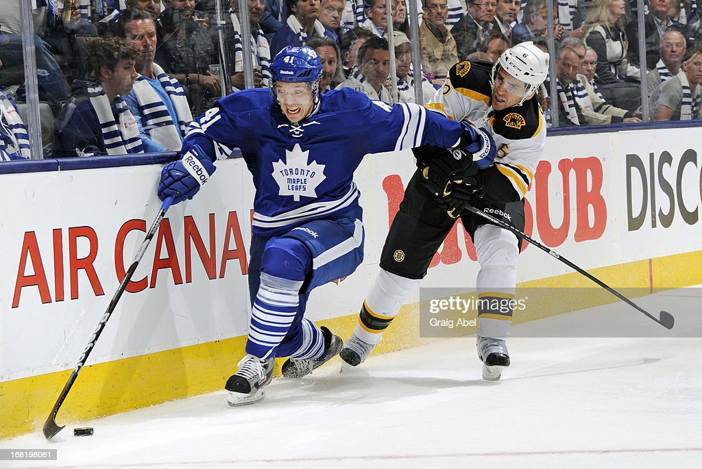 <a gi-track='captionPersonalityLinkClicked' href=/galleries/search?phrase=Nikolai+Kulemin&family=editorial&specificpeople=537949 ng-click='$event.stopPropagation()'>Nikolai Kulemin</a> #41 of the Toronto Maple Leafs battles for the puck with <a gi-track='captionPersonalityLinkClicked' href=/galleries/search?phrase=Wade+Redden&family=editorial&specificpeople=201471 ng-click='$event.stopPropagation()'>Wade Redden</a> #6 of the Boston Bruins in Game Three of the Eastern Conference Quarterfinals during the 2013 NHL Stanley Cup Playoffs May 6, 2013 at the Air Canada Centre in Toronto, Ontario, Canada.