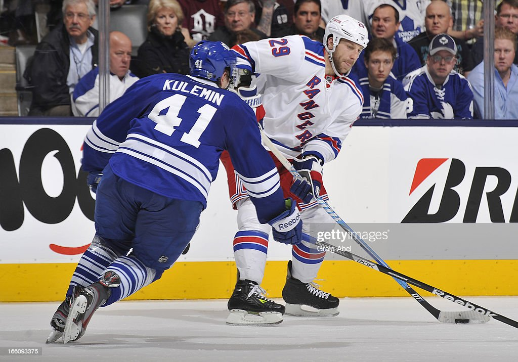 Nikolai Kulemin #41 of the Toronto Maple Leafs defends as Ryane Clowe #29 of the New York Rangers looks to pass the puck during NHL game action April 8, 2013 at the Air Canada Centre in Toronto, Ontario, Canada.