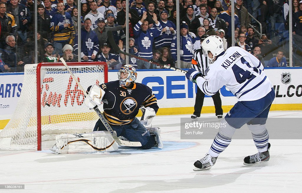 <a gi-track='captionPersonalityLinkClicked' href=/galleries/search?phrase=Nikolai+Kulemin&family=editorial&specificpeople=537949 ng-click='$event.stopPropagation()'>Nikolai Kulemin</a> #41 of the Toronto Maple Leafs fires the puck past Ryan Miller #30 of the Buffalo Sabres on a third period penalty shot at First Niagara Center on December 16, 2011 in Buffalo, New York.
