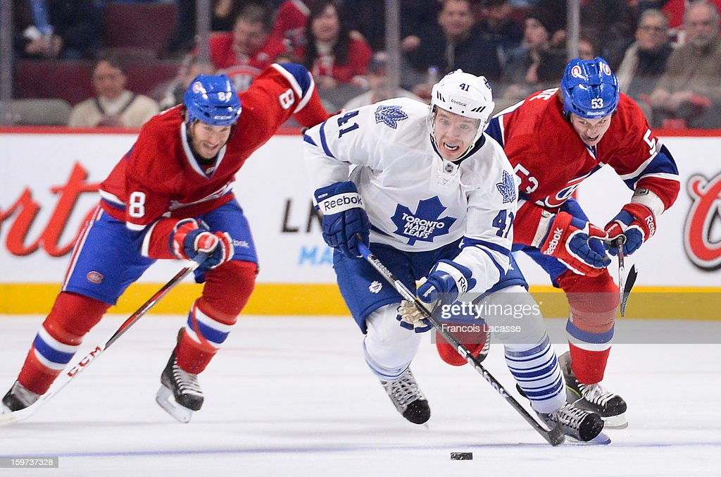 <a gi-track='captionPersonalityLinkClicked' href=/galleries/search?phrase=Nikolai+Kulemin&family=editorial&specificpeople=537949 ng-click='$event.stopPropagation()'>Nikolai Kulemin</a> #41 of the Toronto Maple Leafs is being chased by <a gi-track='captionPersonalityLinkClicked' href=/galleries/search?phrase=Ryan+White+-+Ice+Hockey+Player&family=editorial&specificpeople=16069622 ng-click='$event.stopPropagation()'>Ryan White</a> #53 and <a gi-track='captionPersonalityLinkClicked' href=/galleries/search?phrase=Brandon+Prust&family=editorial&specificpeople=2221796 ng-click='$event.stopPropagation()'>Brandon Prust</a> #8 of the Montreal Canadiens during the NHL game on January 19, 2013 at the Bell Centre in Montreal, Quebec, Canada.
