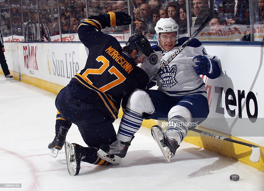 Nikolai Kulemin of the Toronto Maple Leafs is hit by Shaone Morrisonn of the Buffalo Sabres at the Air Canada Centre on November 6 2010 in Toronto...