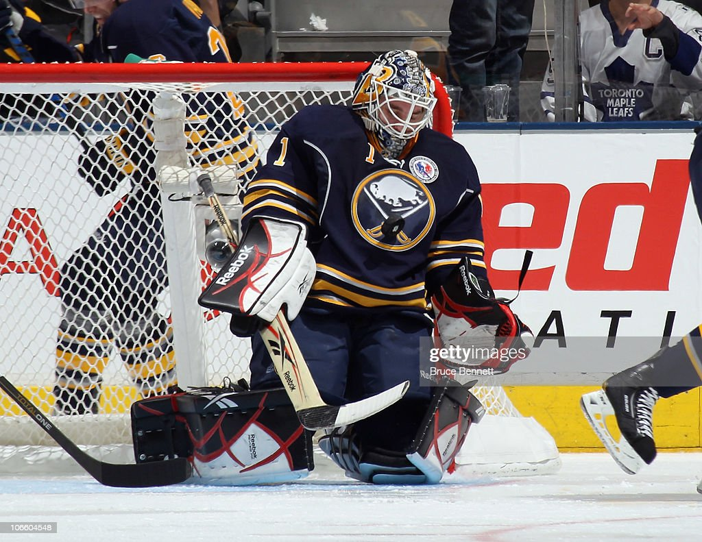 Nikolai Kulemin of the Toronto Maple Leafs is stopped by Jhonas Enroth of the Buffalo Sabres at the Air Canada Centre on November 6 2010 in Toronto...