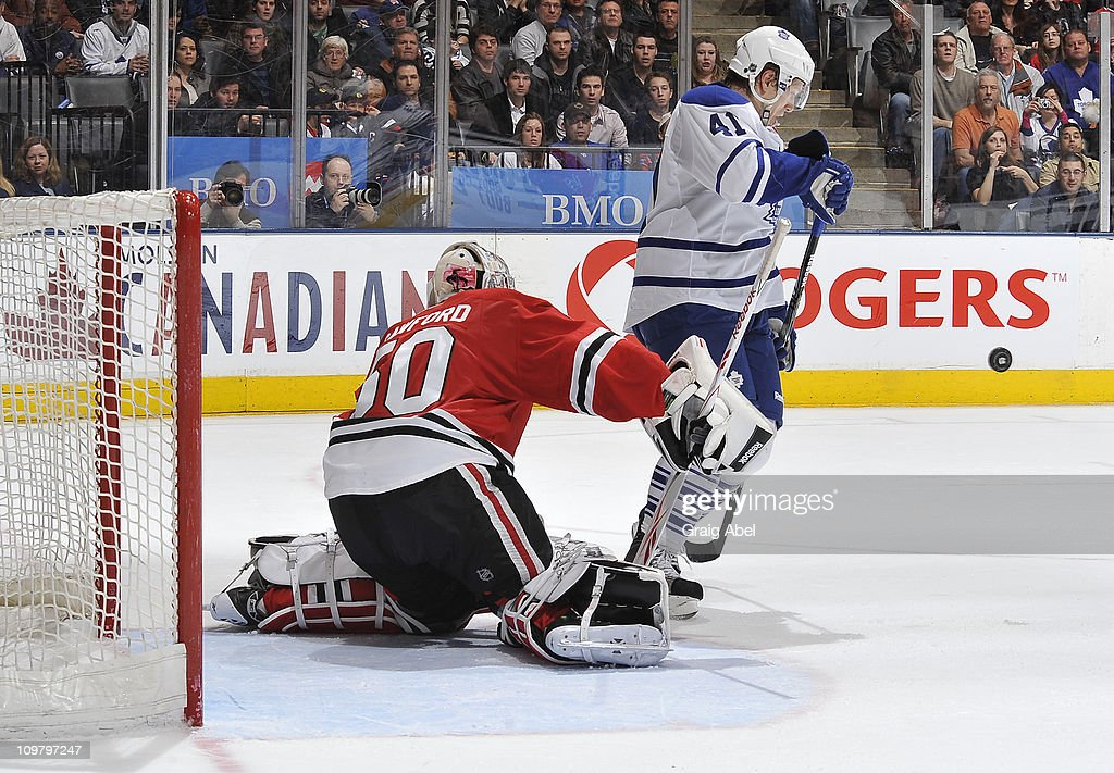 <a gi-track='captionPersonalityLinkClicked' href=/galleries/search?phrase=Nikolai+Kulemin&family=editorial&specificpeople=537949 ng-click='$event.stopPropagation()'>Nikolai Kulemin</a> #41 of the Toronto Maple Leafs is topped in close by Corey Crawford #50 of the Chicago Blackhawks March 5, 2011 at the Air Canada Centre in Toronto, Ontario, Canada.