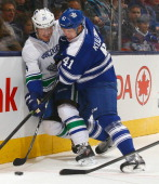 Nikolai Kulemin of the Toronto Maple Leafs rubs out Alex Burrows of the Vancouver Canucks during NHL action at the Air Canada Centre February 8 2014...