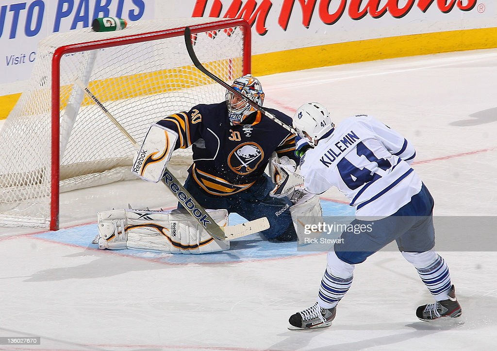 <a gi-track='captionPersonalityLinkClicked' href=/galleries/search?phrase=Nikolai+Kulemin&family=editorial&specificpeople=537949 ng-click='$event.stopPropagation()'>Nikolai Kulemin</a> #41 of the Toronto Maple Leafs scores on a penalty shot against Ryan Miller #30 of the Buffalo Sabres in the third period at First Niagara Center on December 16, 2011 in Buffalo, New York.