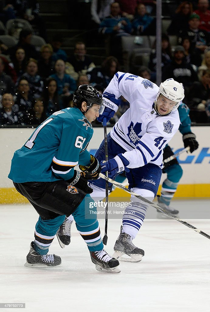 <a gi-track='captionPersonalityLinkClicked' href=/galleries/search?phrase=Nikolai+Kulemin&family=editorial&specificpeople=537949 ng-click='$event.stopPropagation()'>Nikolai Kulemin</a> #41 of the Toronto Maple Leafs shoots his shot past Justin Braun #61 of the San Jose Sharks during the third period at SAP Center on March 11, 2014 in San Jose, California.