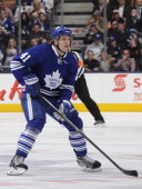 Nikolai Kulemin of the Toronto Maple Leafs skates during NHL game action against the Detroit Red Wings March 29 2014 at the Air Canada Centre in...