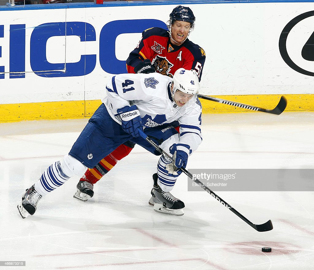 Nikolai Kulemin #41 of the Toronto Maple Leafs skates with the puck against Brian Campbell #51 of the Florida Panthers at the BB&T Center on February 4, 2014 in Sunrise, Florida.