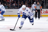 Nikolai Kulemin of the Toronto Maple Leafs skates with the puck against the Los Angeles Kings at Staples Center on March 13 2014 in Los Angeles...