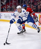 Nikolai Kulemin of the Toronto Maple Leafs tries to keep the puck from PK Subban of the Montreal Canadiens during the NHL game on March 1 2014 at the...