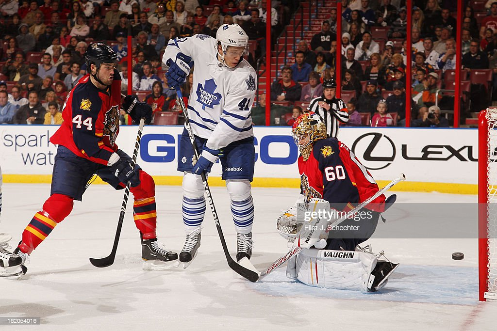 Nikolai Kulemin #41 of the Toronto Maple Leafs tries to tip in the puck against Goaltender Jose Theodore #60 of the Florida Panthers at the BB&T Center on February 18, 2013 in Sunrise, Florida.