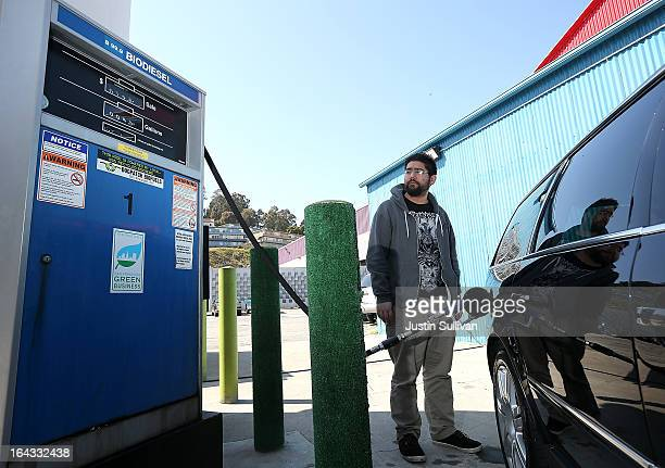 Nikolai Kunz pumps biodiesel into his car at Dogpatch Biofuels on March 22 2013 in San Francisco California According to a report by San Francisco...