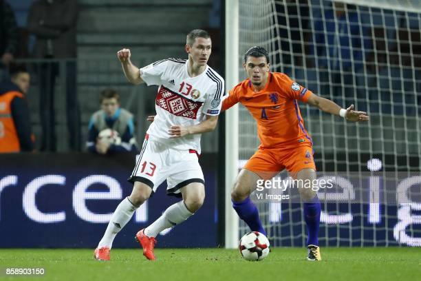 Nikolai Signevich of Belarus Karim Rekik of Holland during the FIFA World Cup 2018 qualifying match between Belarus and Netherlands on October 07...