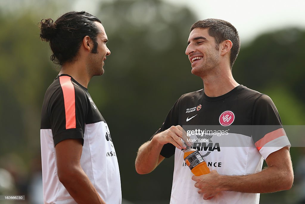 Nikolai Topor-Stanley and Iacopo La Rocca speak during warm-up at a Western Sydney Wanderers A-League training session at Blacktown International Sportspark on February 26, 2013 in Sydney, Australia.