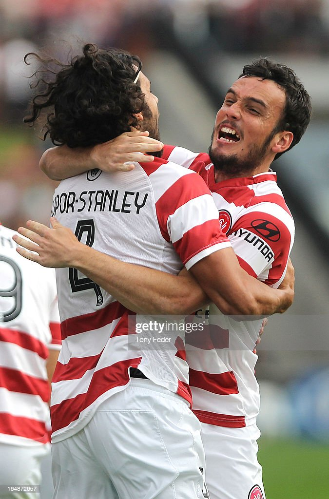 Nikolai Topor-Stanley and Mateo Poljak (R) of the Wanderers celebrate a goal during the round 27 A-League match between the Newcastle Jets and Western Sydney at Hunter Stadium on March 29, 2013 in Newcastle, Australia.