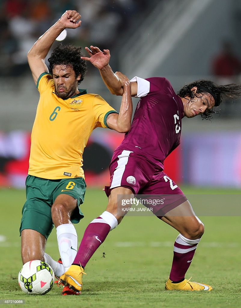 Nikolai ToporStanley of Australia fights for the ball with Qatar's Sebastian Soria during their friendly football match in Doha on October 14 2014...