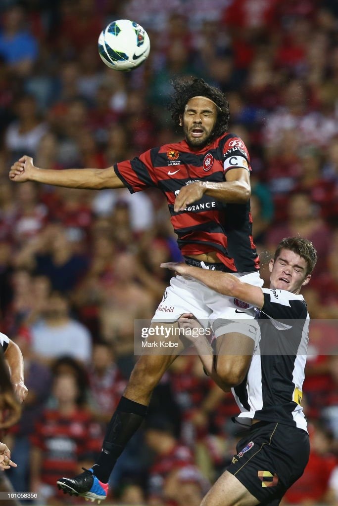 Nikolai Topor-Stanley of the Wanderers and Connor Chapman of the Jets compete for the ball the ball during the round 20 A-League match between the Western Sydney Wanderers and the Newcastle Jets at Campbelltown Sports Stadium on February 9, 2013 in Sydney, Australia.