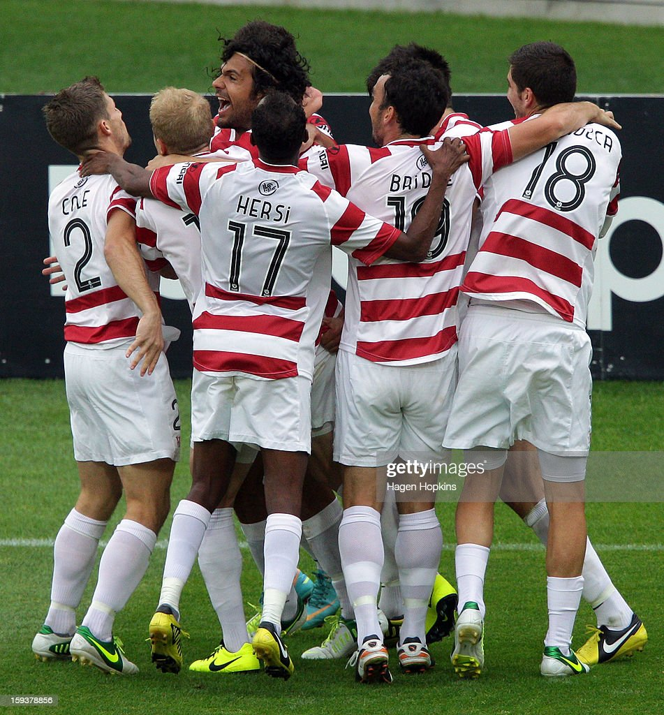 Nikolai Topor-Stanley of the Wanderers is congratulated by teammates after scoring a goal during the round 16 A-League match between the Wellington Phoenix and the Western Sydney Wanderers at Westpac Stadium on January 13, 2013 in Wellington, New Zealand.