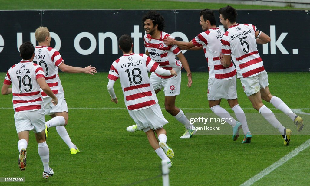 Nikolai Topor-Stanley (centre) of the Wanderers is congratulated by teammates after scoring a goal during the round 16 A-League match between the Wellington Phoenix and the Western Sydney Wanderers at Westpac Stadium on January 13, 2013 in Wellington, New Zealand.
