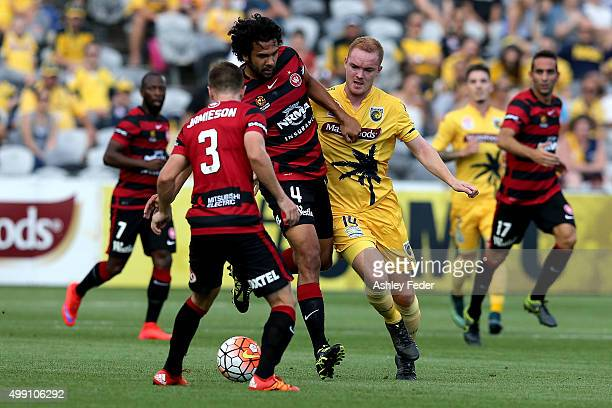 Nikolai ToporStanley of the Wanderers is contested by Daniel Heffernan of the Mariners during the round eight ALeague match between the Central Coast...